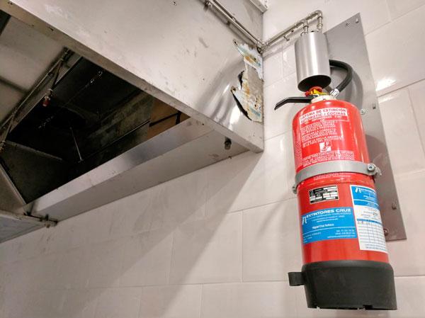 sistema de extinción automático en campana de cocina